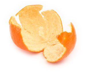 close-up of orange zest on white, natural shadow in front, shallow DOF, see also: